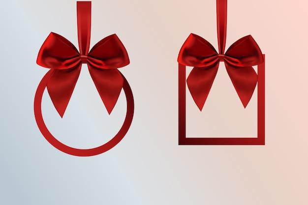 白で隔離のサテンリボンで作られたリボンの正方形のフレームとクリスマスの赤い弓