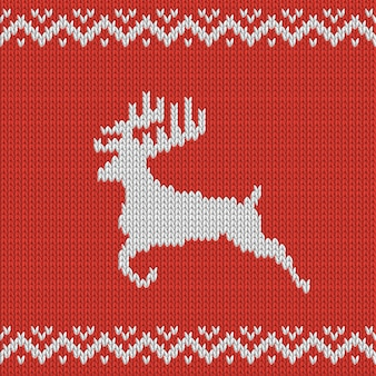 Christmas red knitted pattern with deer