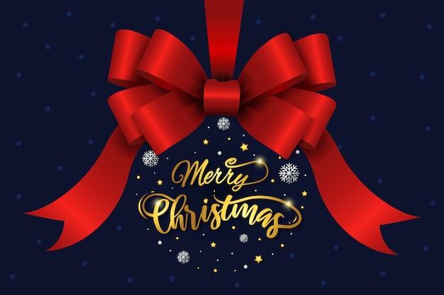 クリスマスの赤いリボンとレタリングの背景