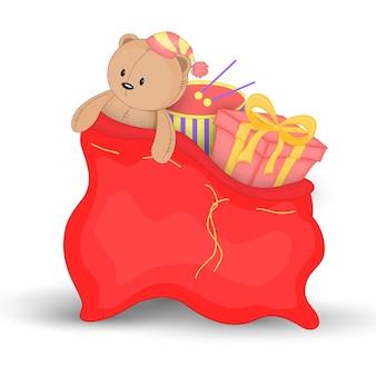 ギフトやおもちゃのクリスマスの赤い袋。サンタクロースのかわいいクリスマスバッグ。白い背景で隔離。ぬいぐるみテディベア。