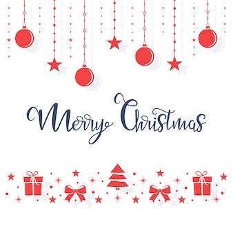 Рождественские красные игрушки висят на веревке на белом фоне.
