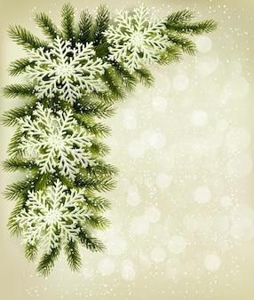 クリスマスツリーの枝と雪片とクリスマスのレトロな背景。