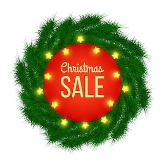 Christmas sale advertising banner decorated with fir branches and light garlands on white background