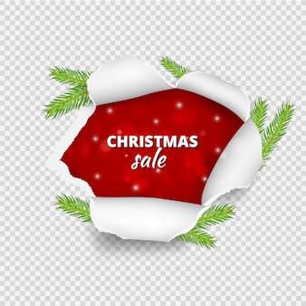 クリスマスセールのバナー。クリスマスツリーの枝で破れた紙の穴。現実的な破れた紙シート