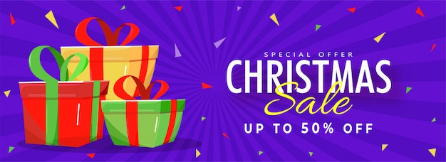 Christmas sale banner with 50% discount offer and gift boxes on purple rays background.