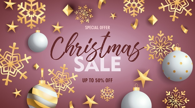 Christmas sale banner with baubles and golden snowflakes