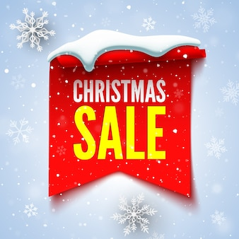 Christmas sale banner with red ribbon, snow cap and snowflakes.