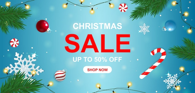 Christmas sale banner with sweets and snowflakes.
