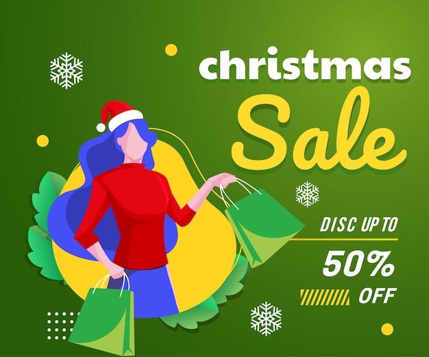 女性のショッピングの背景とクリスマスセールバナー