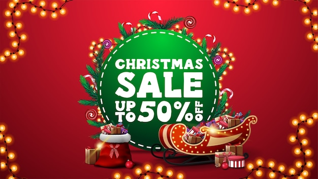 Christmas sale, discount banner with green circle decorated with christmas tree branches and garland