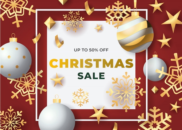 Christmas sale in frame with baubles and snowflakes