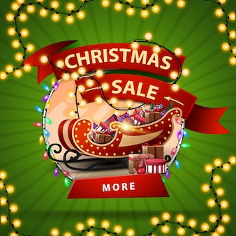 Christmas sale round discount banner with a ribbon wrapped in a garland