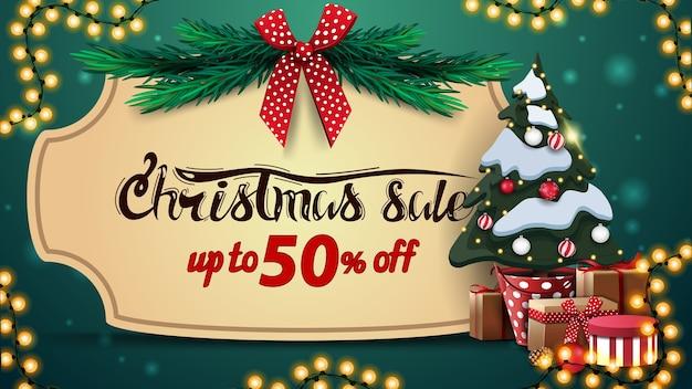 クリスマスセール、最大50オフ、ビンテージフレーム付きの緑の割引バナー