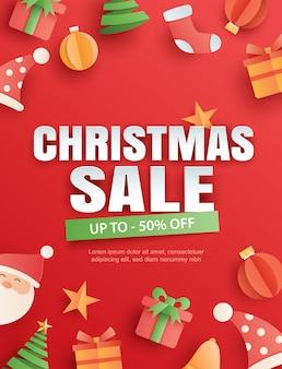 Рождественская распродажа с объектом и символом на красном в стиле бумажного искусства.