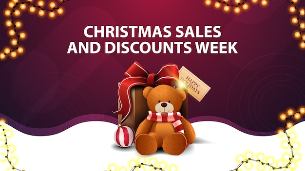 Неделя рождественских распродаж и скидок, бело-фиолетовый баннер со скидками с гирляндой, волнистой линией и подарком с мишкой тедди