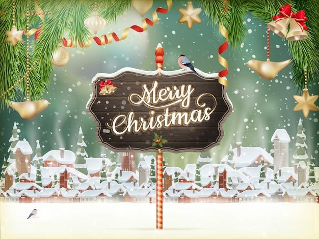 크리스마스 장면, 눈이 나무와 작은 마을에 덮여있다.