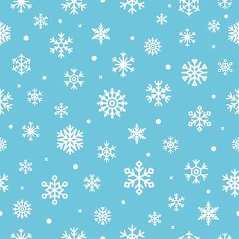 雪片とクリスマスのシームレスなパターン。