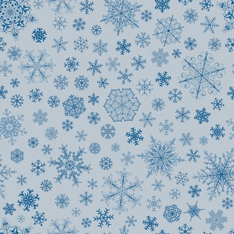 Christmas seamless pattern of big and small snowflakes, blue on light blue