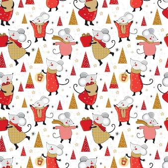 クリスマスのシームレスなパターン。ギフトとかわいい漫画のマウス