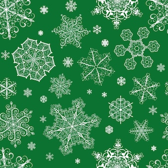 Christmas seamless pattern from big and small white snowflakes on green background