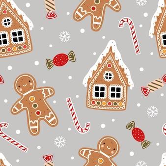 クリスマスのシームレスなパターン。ジンジャーブレッドマン、キャンディケイン、ジンジャーブレッドハウス、キャンディー、灰色の背景に雪片
