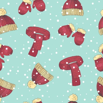 Christmas seamless pattern of hand drawn colored hat, scarf and mittens in a sketch style.