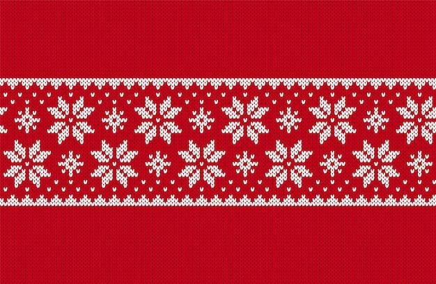 クリスマスのシームレスなパターン。ニットの赤い質感。ベクトルイラスト。