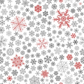 Рождественский фон из больших и маленьких снежинок, красных и серых на белом