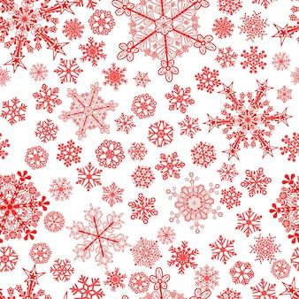 Рождественский фон из больших и маленьких снежинок, красный на белом