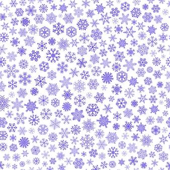 小さな雪片のクリスマスのシームレスなパターン、白地に青