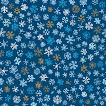 小さな雪のクリスマスのシームレスなパターン、水色、茶色、青に白