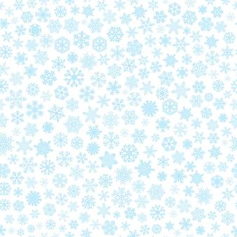 小さな雪のクリスマスのシームレスなパターン、白地に水色