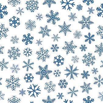 雪片のクリスマスのシームレスなパターン、白地に青