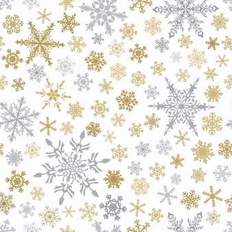 雪片、白い背景の上の灰色と茶色のクリスマスのシームレスなパターン。