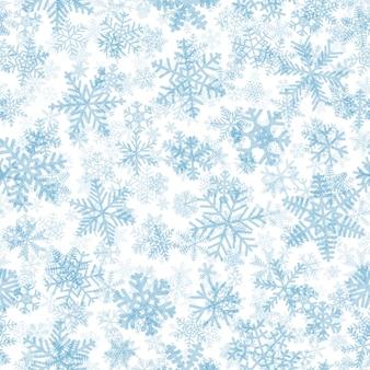 雪片のクリスマスのシームレスなパターン、白地に水色
