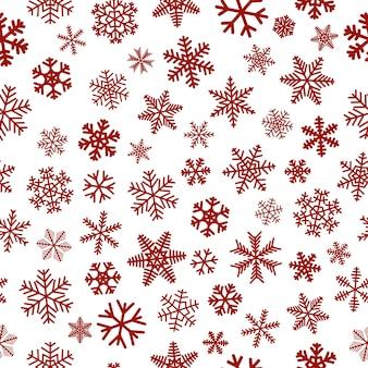 Рождественский фон из снежинок, красный на белом фоне