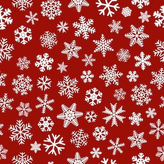 Рождественский фон из снежинок, белый на красном фоне
