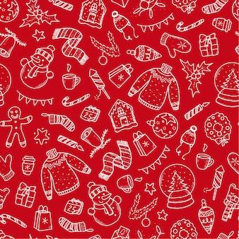 赤い背景の上のクリスマスのシームレスなパターン