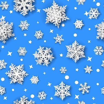 Christmas seamless pattern of paper snowflakes with soft shadows, white on light blue background