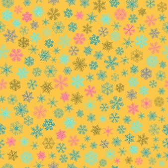 Christmas seamless pattern of small snowflakes, light blue and pink on yellow