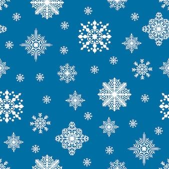 クリスマスのシームレスなパターン。雪の結晶の背景。冬休みのタイル張りの背景。包装紙、プリント、スクラップブッキングのためのグラフィックデザイン要素。休日をテーマにしたデザイン