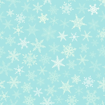 Christmas seamless pattern of snowflakes, white on light blue background.