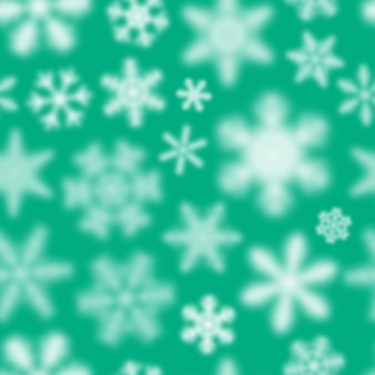 Christmas seamless pattern of white defocused snowflakes on turquoise background
