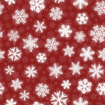 Christmas seamless pattern of white snowflakes of different shapes on red background