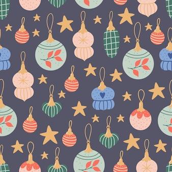 美しいカラフルな休日の装飾品とクリスマスのシームレスなパターン。