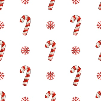 Christmas seamless pattern with candy cane or sweet lollipop and snowflakes