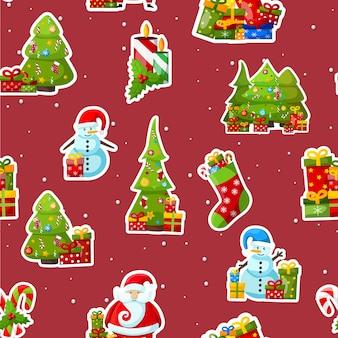 赤のカラフルな冬のシンボルとクリスマスのシームレスなパターン