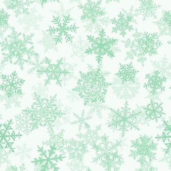 複雑な大小の雪片、白い背景の上の緑とクリスマスのシームレスなパターン