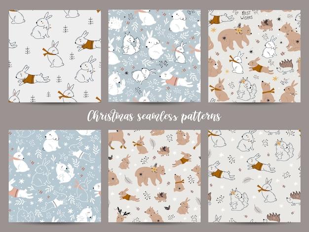 かわいい森の動物のコレクションとクリスマスのシームレスなパターン。