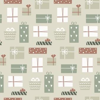 かわいいギフトボックスとクリスマスのシームレスなパターン。手描きのシームレスなパターンの塗りつぶし、包装紙。